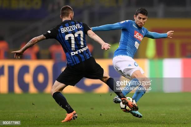 Inter Milan's Croatian midfielder Marcelo Brozovic tackles Napoli's Brazilian midfielder Jorginho during the Italian Serie A football match Inter...