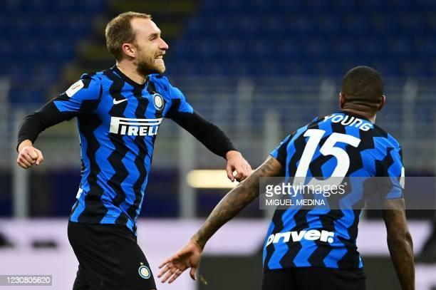 Inter Milan's Danish midfielder Christian Eriksen celebrates after scoring a free kick during the Italian Cup quarter final football match between...