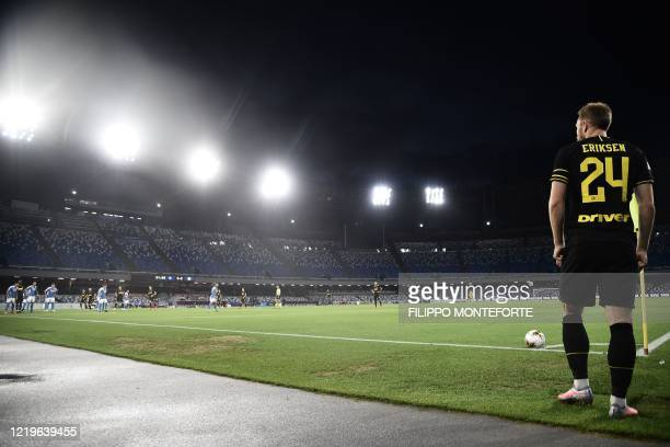 Inter Milan's Danish midfielder Christian Eriksen prepares to shoot a corner kick and open the scoring during the Italian Cup semifinal second leg...