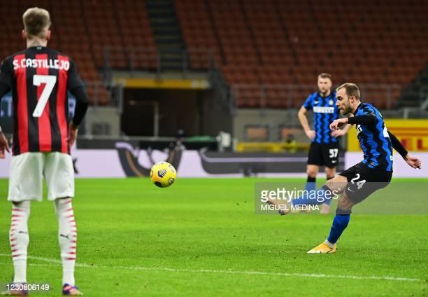 Inter Milan's Danish midfielder Christian Eriksen scores a free kick during the Italian Cup quarter final football match between Inter Milan and AC...