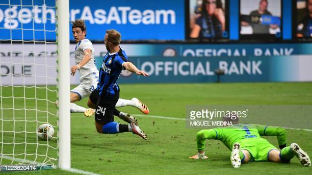 Inter Milan's Danish midfielder Christian Eriksen scores the 5th goal during the Italian Serie A football match Inter vs Brescia played behind closed...