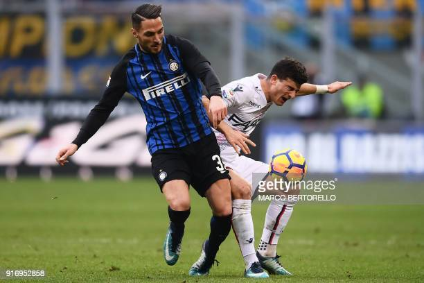 Inter Milan's defender Danilo D'Ambrosio and Bologna's Algerian midfielder Saphir Taider go for the ball during the Italian Serie A football match...