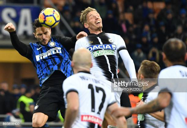 Inter Milan's defender Danilo D'Ambrosio fights for the ball with Udinese's defender Jens Stryger Larsen from Denmark during the Italian Serie A...