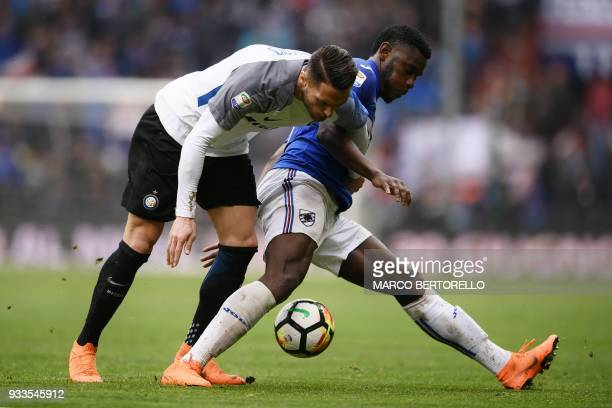 Inter Milan's defender Danilo D'Ambrosio from Italy fights for the ball with Sampdoria's forward Duvan Zapata from Colombia during the Italian Serie...