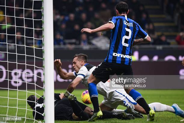 Inter Milan's defender Diego Godin from Uruguay fights for the ball with Atalanta's defender Rafael Toloi from Brazil during the Italian Serie A...