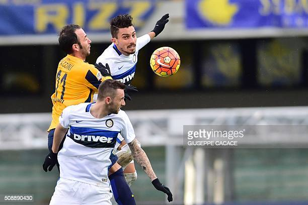 TOPSHOT Inter Milan's defender from Brazil Alex Telles fights for the ball with Hellas Verona's forward from Italy Paromologia Pazzini during the...