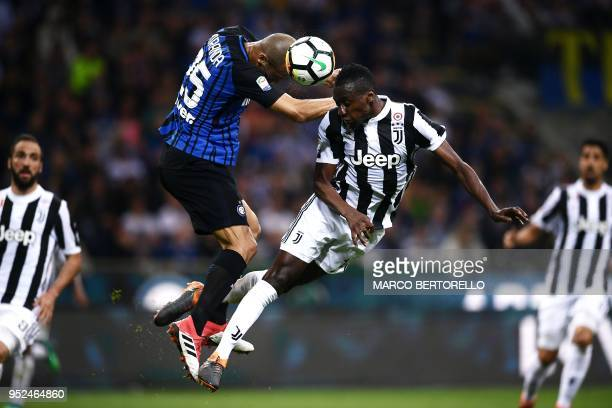 TOPSHOT Inter Milan's defender Joao Miranda de Souza Filho from Brazil jumps for the ball with Juventus' midfielder Blaise Matuidi from France during...
