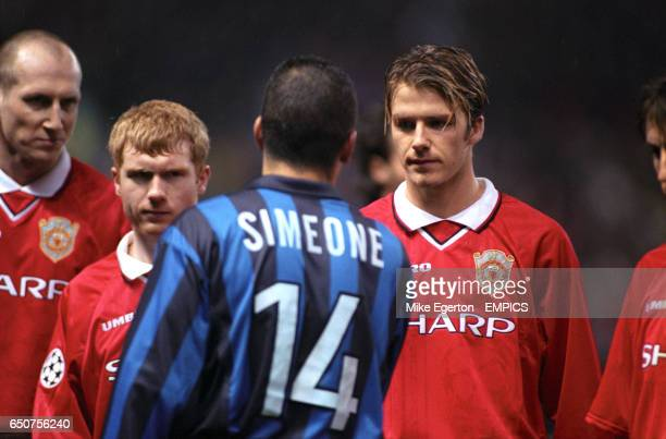 Inter Milan's Diego Simeone shakes hands with Manchester United's David Beckham