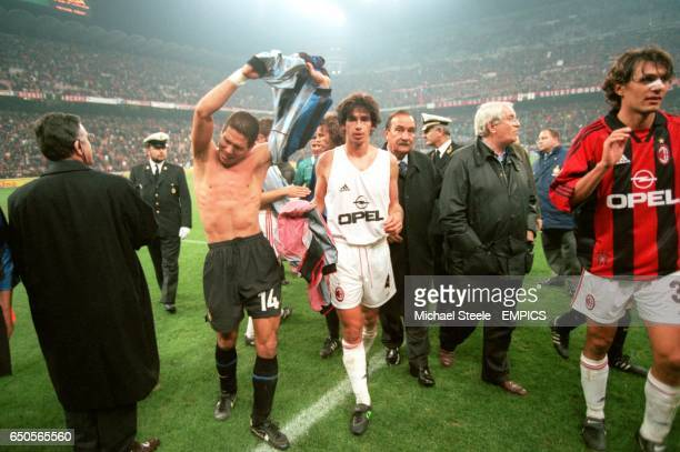 Inter Milan's Diego Simeone swaps shirts with AC Milan's Demetrio Albertini after the match