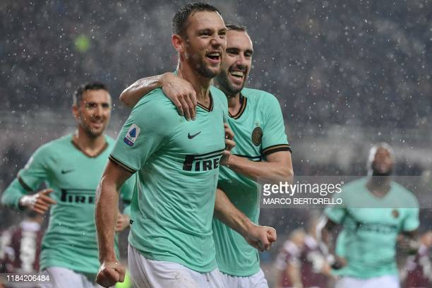 Inter Milan's Dutch defender Stefan de Vrij celebrates with Inter Milan's Uruguayan defender Diego Godin after scoring during the Italian Serie A...