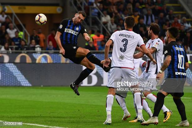 Inter Milan's Dutch defender Stefan de Vrij heads the ball during the Italian Serie A football match Inter Milan vs Cagliari on September 29 2018 at...
