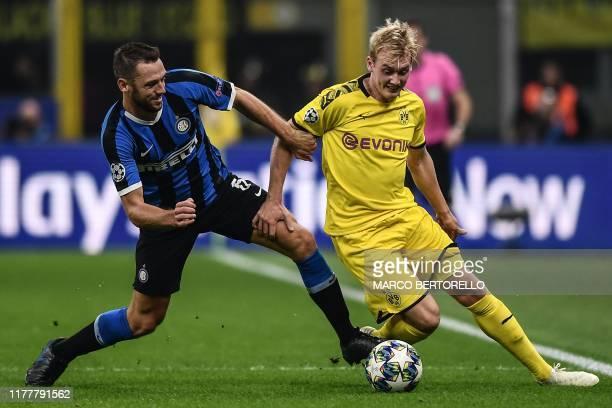 Inter Milan's Dutch defender Stefan de Vrij holds off Dortmund's German forward Julian Brandt during the UEFA Champions League Group F football match...