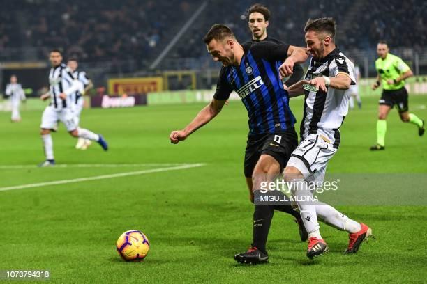 Inter Milan's Dutch defender Stefan de Vrij holds off Udinese's midfielder Marco D'Alessandro during the Italian Serie A football match Inter Milan...