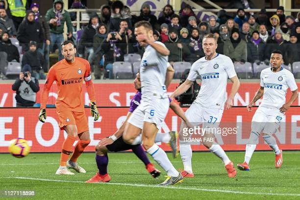 Inter Milan's Dutch defender Stefan de Vrij scores an own goal as Inter Milan's Slovenian goalkeeper Samir Handanovic looks on during the Italian...