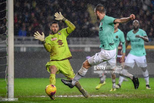 Inter Milan's Dutch defender Stefan de Vrij shoots to score his team's second goal during the Italian Serie A football match Torino vs Inter Milan on...