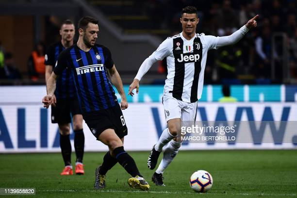 Inter Milan's Dutch defender Stefan De Vrij vies with Juventus' Portuguese forward Cristiano Ronaldo during the Italian Serie A football match...