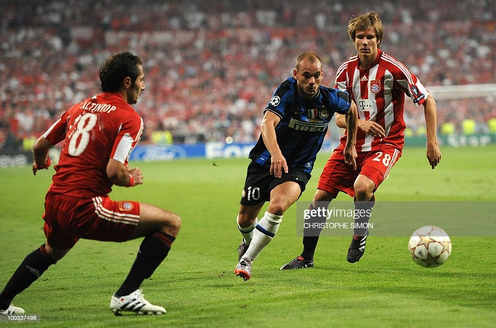Inter Milan's Dutch midfielder Wesley Sneijder (C) vies for the ball with Bayern Munich's Turkish midfielder Hamit Altintop (L) and Bayern Munich's defender Holger Badstuber Inter Milan's Portuguese coach Jose Mourinho celebrates with the ball after the UEFA Champions League final football match Inter Milan against Bayern Munich at the Santiago Bernabeu stadium in Madrid on May 22, 2010. Inter Milan won the Champions League with a 2-0 victory over Bayern Munich in the final at the Santiago Bernabeu. Argentine striker Diego Milito scored both goals for Jose Mourinho's team who completed a treble of trophies this season.