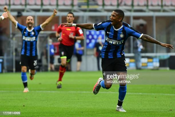 Inter Milan's English midfielder Ashley Young celebrates after opening the scoring during the Italian Serie A football match Inter vs Brescia played...