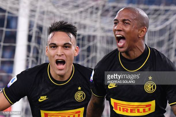 Inter Milan's English midfielder Ashley Young celebrates with Inter Milan's Argentinian forward Lautaro Martinez after opening the scoring during the...