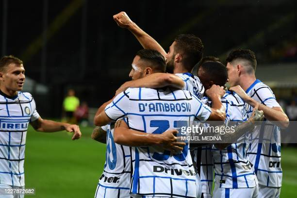 Inter Milan's English midfielder Ashley Young is congratulated by teammates after scoring his team's second goal during the Italian Serie A football...