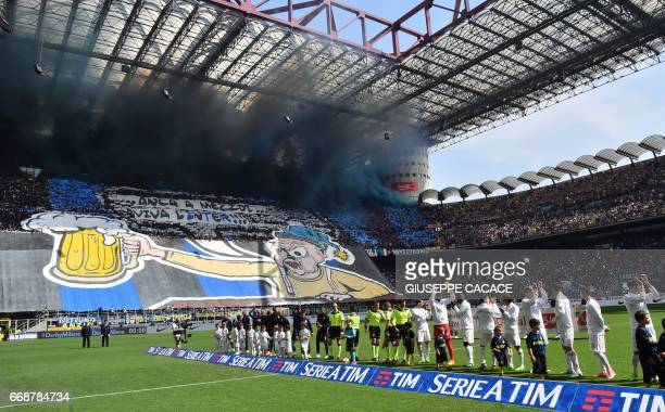 Inter Milan's fans cheer before the Italian Serie A football match Inter Milan vs AC Milan at 'San Siro' Stadium in Milan on April 15 2017 The match...