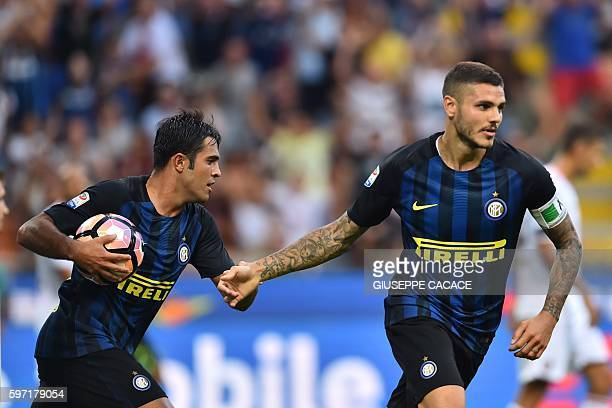 Inter Milan's forward from Argentina Mauro Icardi celebrates after scoring a goal next to Inter Milan's midfielder from Argentina Ever Banega during...