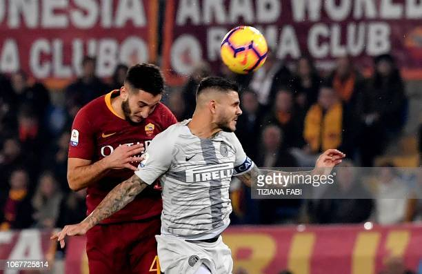 Inter Milan's forward from Argentina Mauro Icardi fights for the ball with AS Roma Greek defender Konstantinos Manolas Icardi during the Italian...