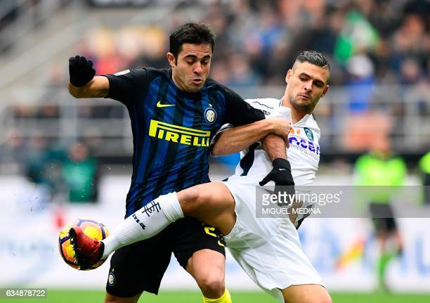 TOPSHOT Inter Milan's forward from Brazil Eder vies with Empoli's French defender Vincent Laurini during the Serie A match between Inter Milan and...