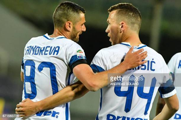 Inter Milan's forward from Croatia Ivan Perisic celebrates with his teammate Antonio Candreva after scoring during the Italian Serie A football match...