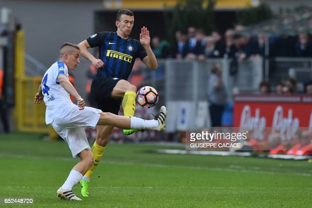 Inter Milan's forward from Croatia Ivan Perisic fights for the ball with Atalanta's defender from Italy Andrea Conti during the Italian Serie A...