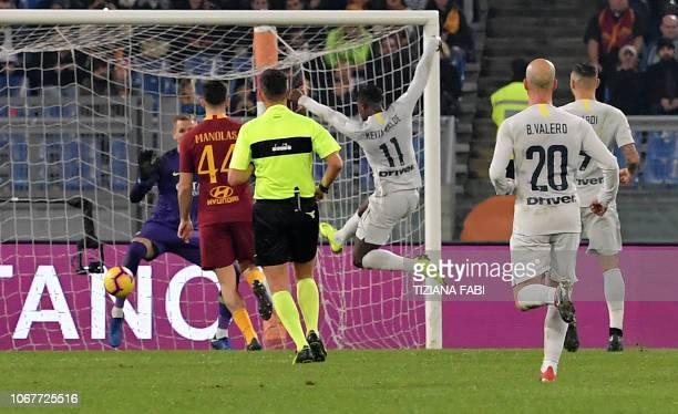 Inter Milan's forward from Senegal Keita Balde celebrates after scoring against Roma during the Italian Serie A football match Roma and Inter at the...