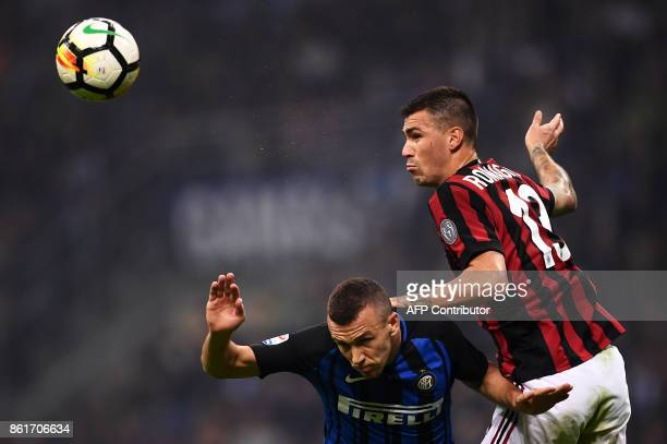 Inter Milan's forward Ivan Perisic from Croatia fights for the ball with AC Milan's defender Alessio Romagnoli during the Italian Serie A football...