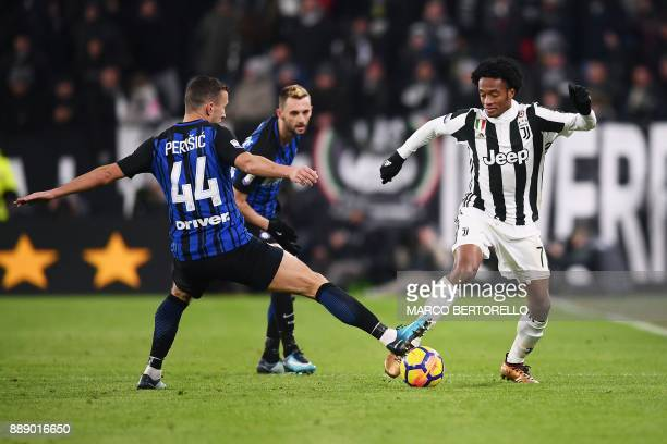 Inter Milan's forward Ivan Perisic from Croatia fights for the ball with Juventus' midfielder Juan Cuadrado from Colombia during the Italian Serie A...