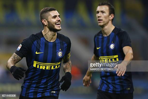 Inter Milan's forward Mauro Emanuel Icardi from Argentina celebrates after scoring with his teammate Inter Milan's forward Ivan Perisic from Croatia...