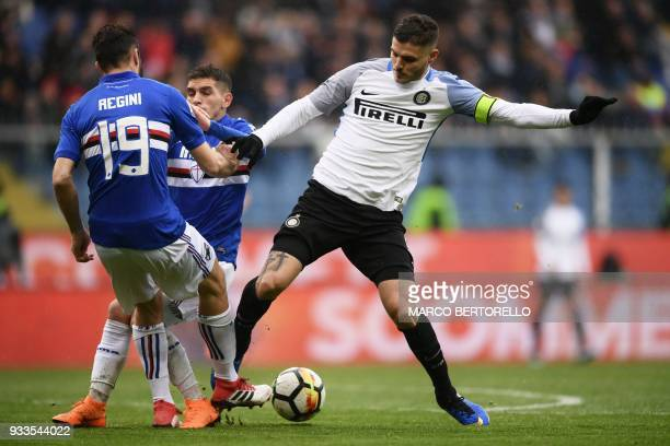 Inter Milan's forward Mauro Emanuel Icardi from Argentina fights for the ball with Sampdoria's defender Vasco Regini during the Italian Serie A...