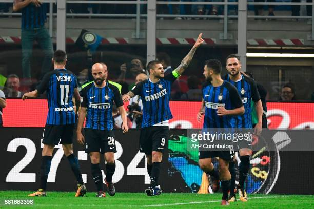 Inter Milan's forward Mauro Icardi from Argentina celebrates after scoring during the Italian Serie A football match Inter Milan Vs AC Milan on...