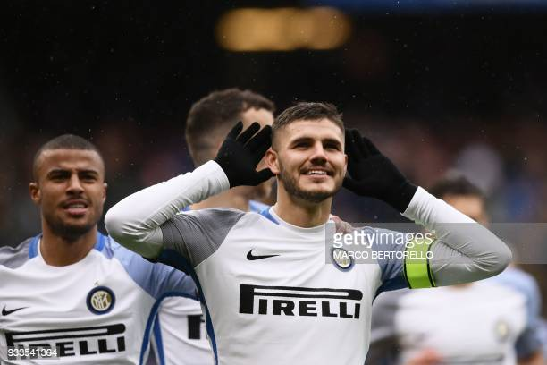 Inter Milan's forward Mauro Icardi from Argentina celebrates after scoring during the Italian Serie A football match Sampdoria Vs Inter Milan on...