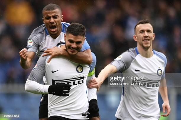 Inter Milan's forward Mauro Icardi from Argentina celebrates after scoring with Inter Milan's forward Rafinha Alcantara of Brazil and Inter Milan's...