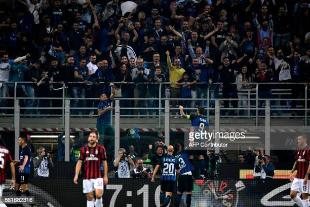 Inter Milan's forward Mauro Icardi from Argentina celebrates with fans after scoring during the Italian Serie A football match Inter Milan Vs AC...
