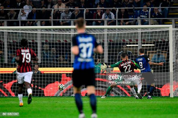 Inter Milan's forward Mauro Icardi from Argentina scores during the Italian Serie A football match Inter Milan Vs AC Milan on October 15 2017 at the...
