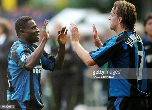 Inter Milan's forward Obafemi Martins celebrates with his teammate Andy Van Der Meyde after scoring against Parma in the Italian Serie A football...