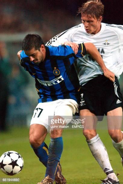 Inter Milan's Francesco Coco holds off the challenge of Rosenborg's Frode Johnsen