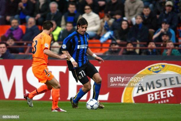 Inter Milan's Francesco Coco takes on Valencia's Anthony Reveillere