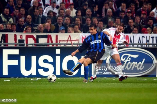 Inter Milan's Francesco Cocu passes the ball back under pressure from Ajax's Andy Van Der Meyde