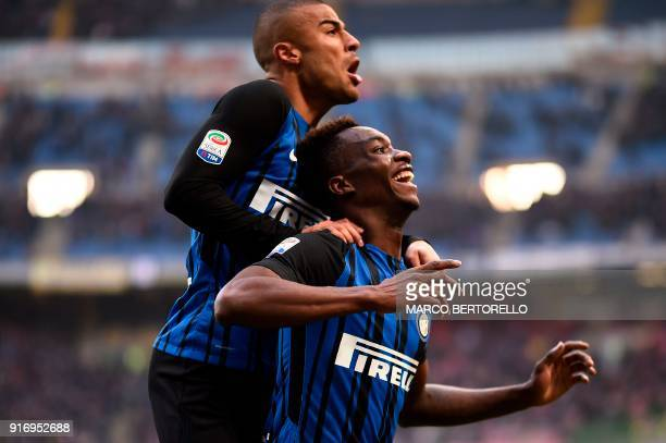 Inter Milan's French forward Yann Karamoh celebrates with teammate Brazilian midfielder Rafinha Alcantara after scoring during the Italian Serie A...