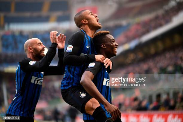Inter Milan's French forward Yann Karamoh celebrates with teammates midfielder Borja Valero and Brazilian midfielder Rafinha Alcantara after scoring...