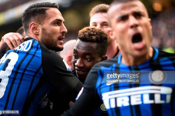 Inter Milan's French forward Yann Karamoh celebrates with teammates and defender Danilo D'Ambrosio after scoring during the Italian Serie A football...
