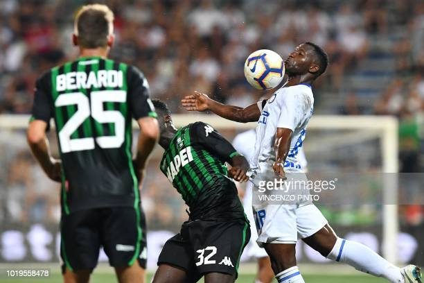 Inter Milan's Ghanaian midfielder Kwadwo Asamoah chest controls the ball during the Italian Serie A football match Sassuolo vs Inter Milan at the...