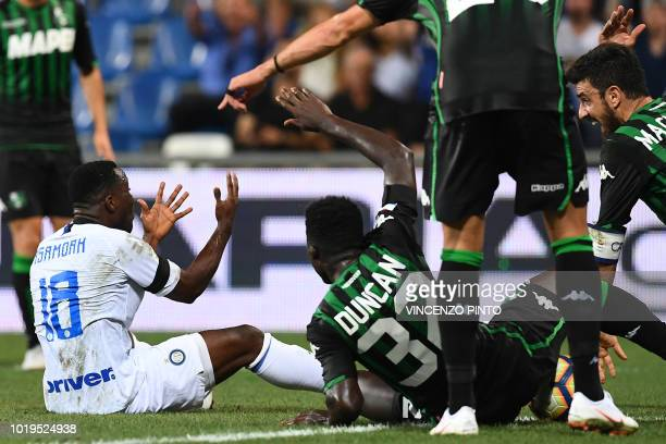 Inter Milan's Ghanaian midfielder Kwadwo Asamoah , Sassuolo's Ghanaian midfielder Alfred Duncan and Sassuolo's midfielder Francesco Magnanelli react...