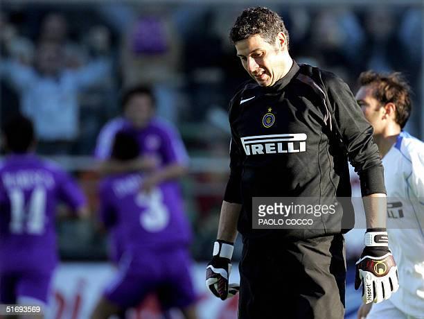 Inter Milan's goalkeeper Francesco Toldo [R] looks dejected after Fiorentina's defender Dario Dainelli [L n. 3] scored against Inter Milan during...